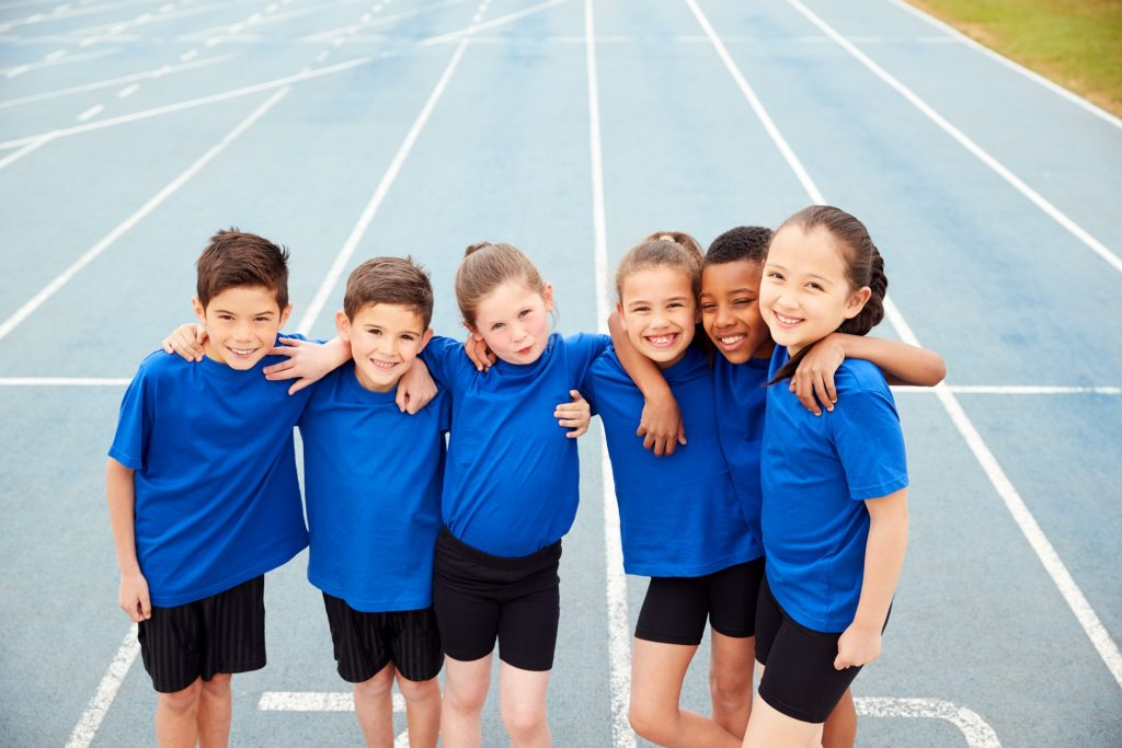 Portrait Of Children In Athletics Team On Track On Sports Day