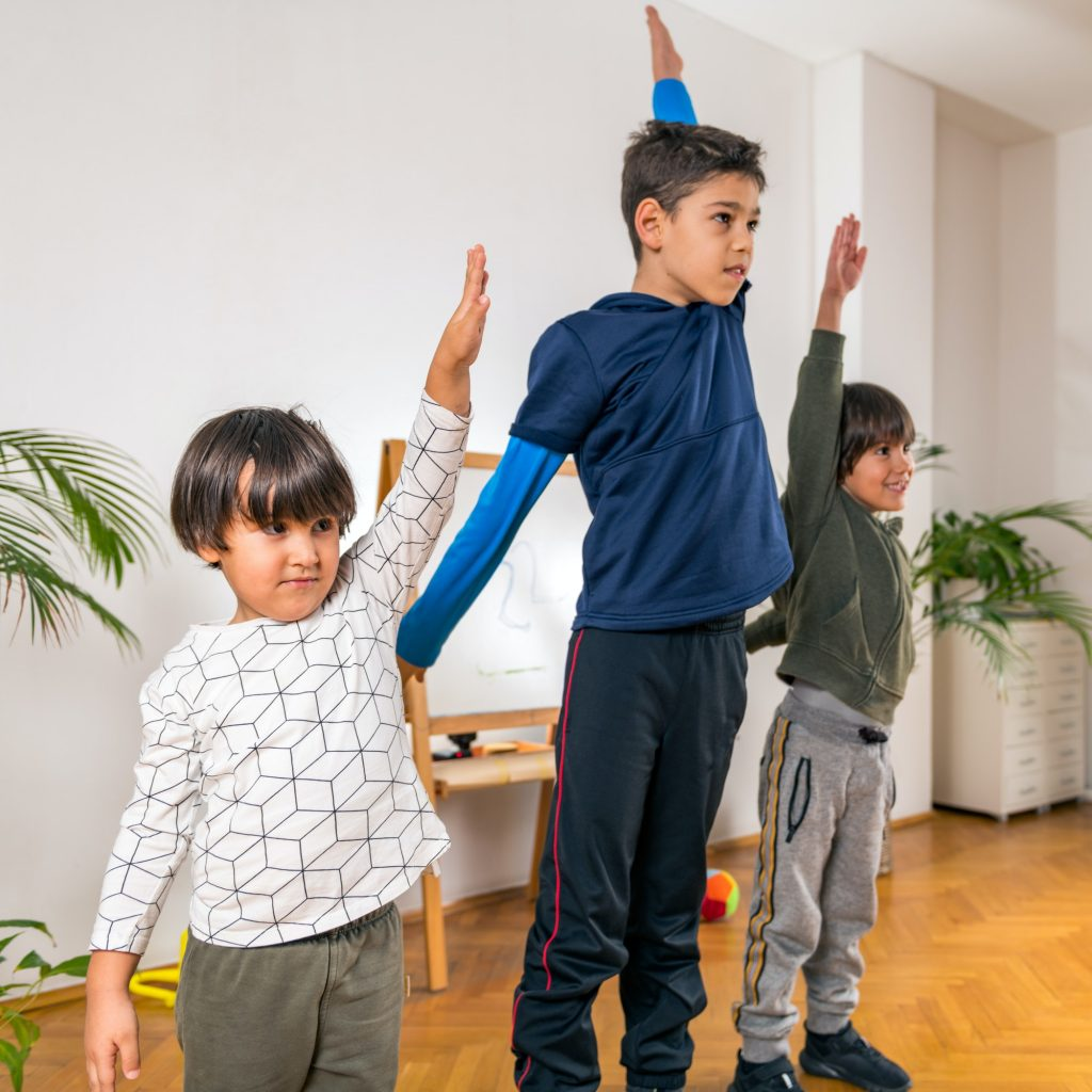 Boys Exercising in Kindergarten